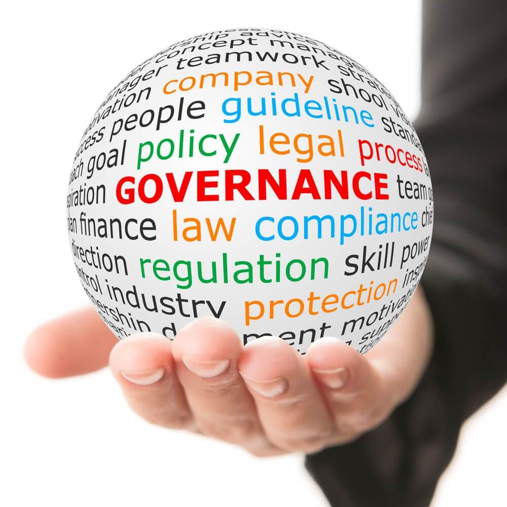 data governance image of hand holding globe